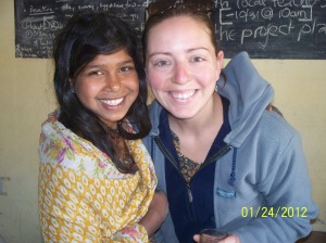 Me with a local migrant girl living near the Janauri community