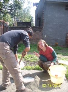 Never a dull day.Here Mandy and Gulshan are mixing cement for building the compost bins.