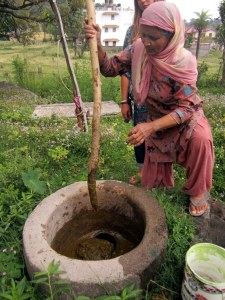Then, she mixed the dung and water together and removed the stone that allows the mixture to enter the reservoir where anaerobic digestion occurs.